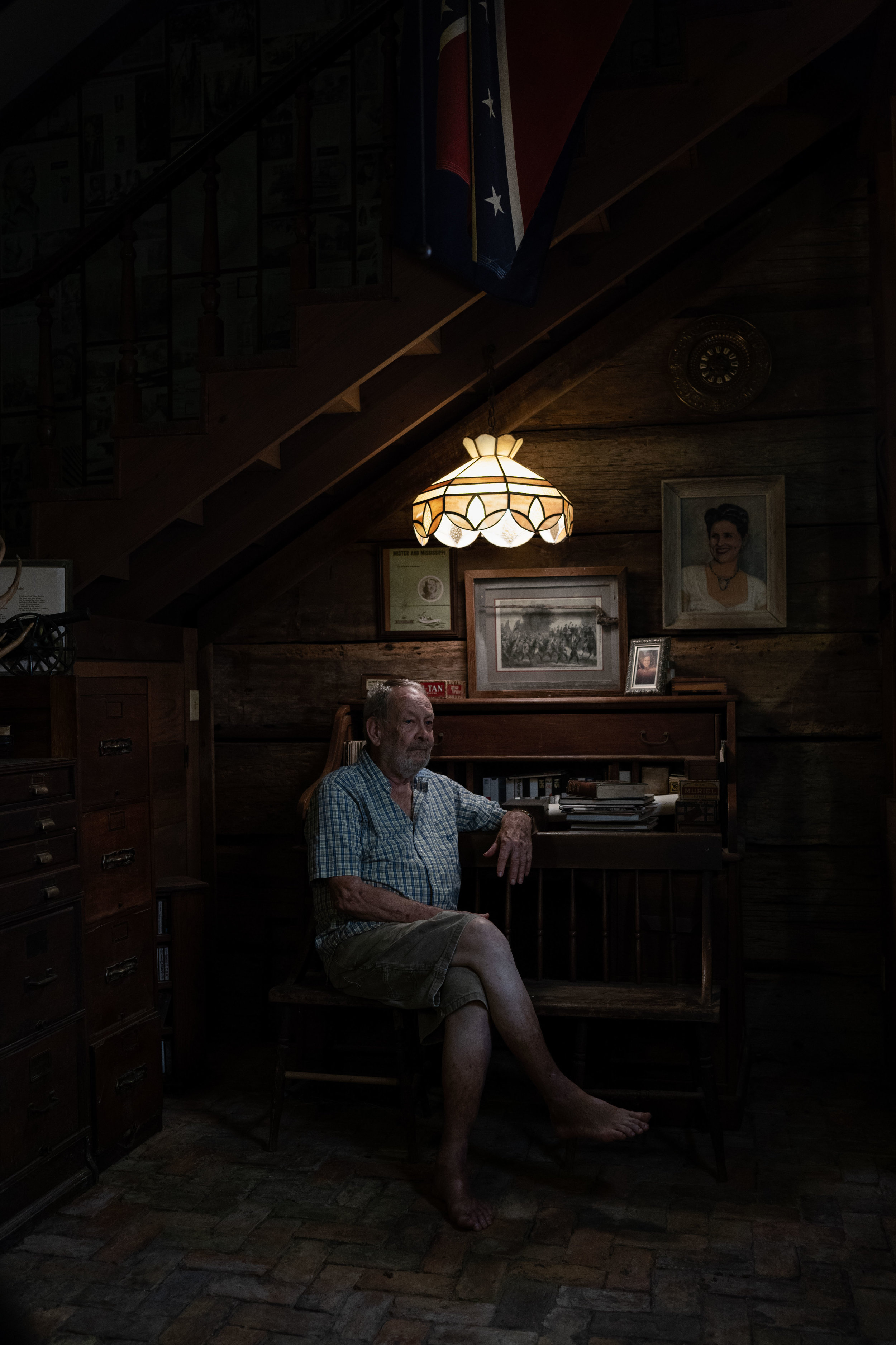Gordon Cotton, a retired journalist fervently opposed to the removal of Confederate monuments, poses for a portrait at his home in Vicksburg, Mississippi.