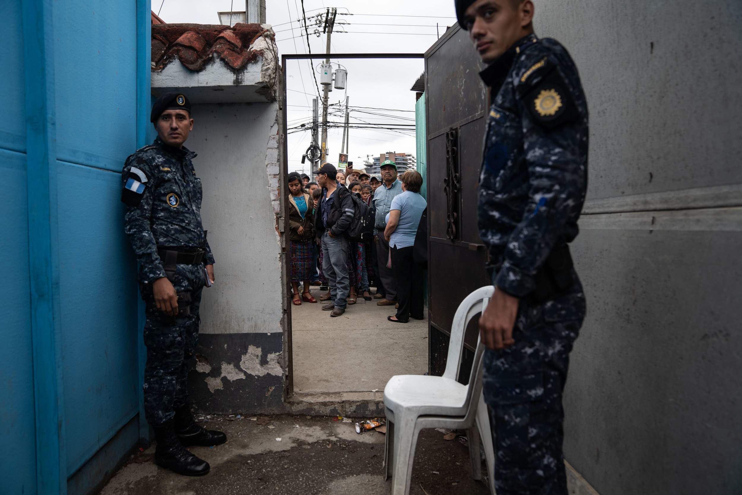 Family members and loved ones wait for Guatemalan deportees to exit a Repatriation Center in Guatemala City in May, 2019.
