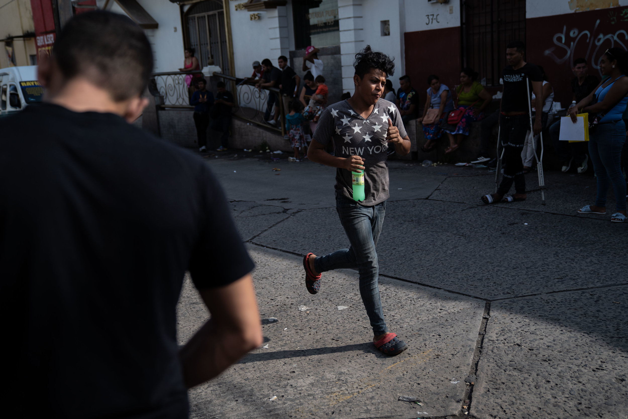 A migrant runs outside the Mexican Commission for Refugee Assistance (COMAR) in Tapachula, Mexico in June, 2019.