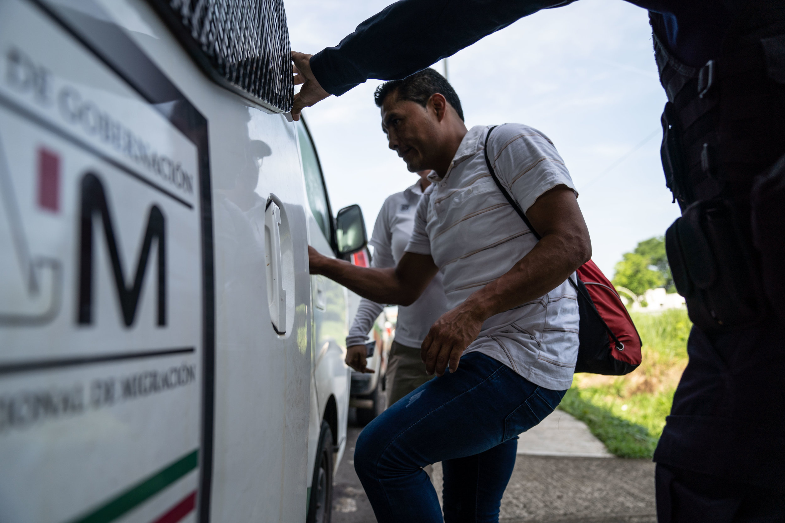 An undocumented migrant is detained at a checkpoint in Tapachula, Mexico in June, 2019.
