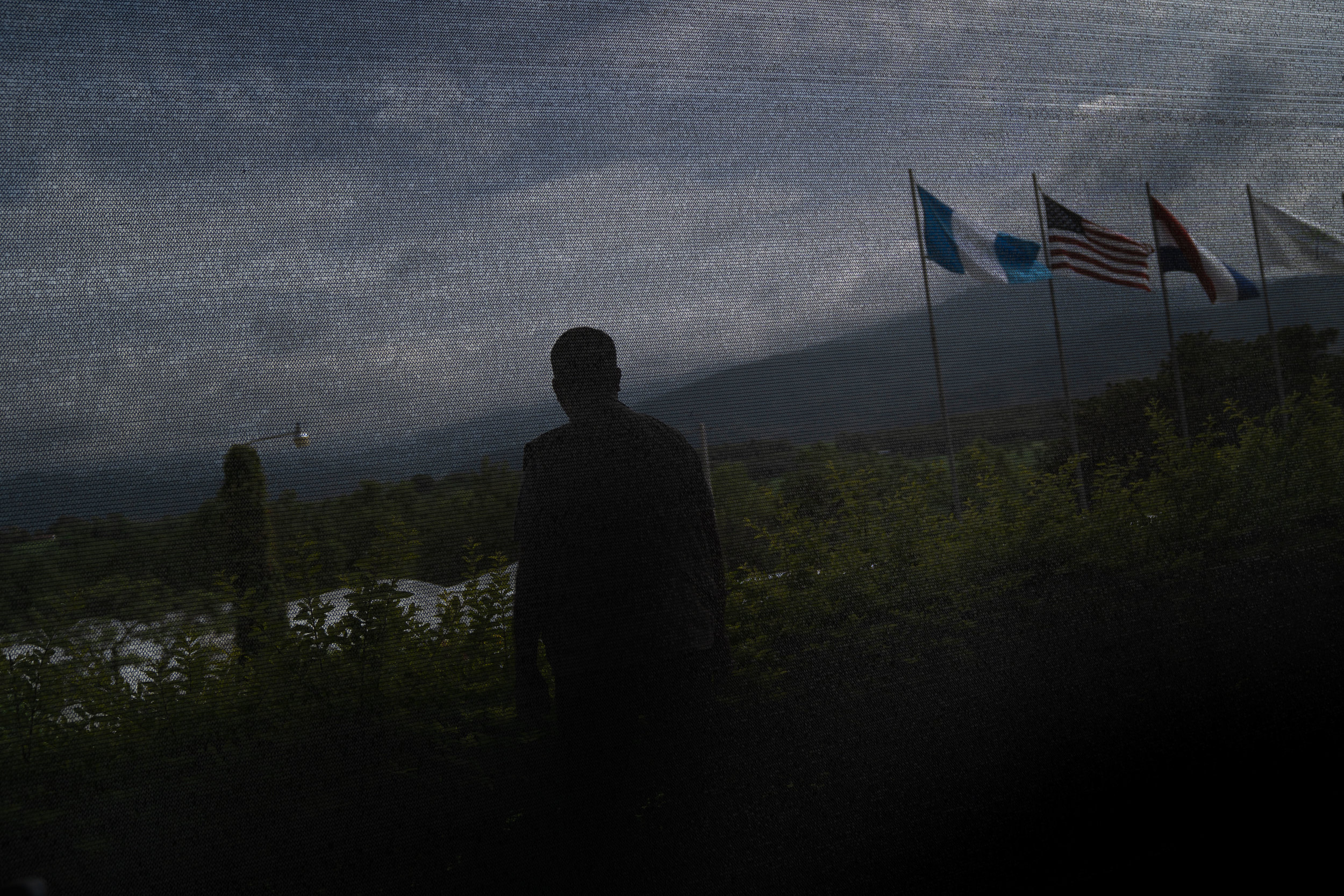 A guard stands in a farm during Acting Secretary of Homeland Security Kevin McAleenan's visit to Guatemala in June, 2019.
