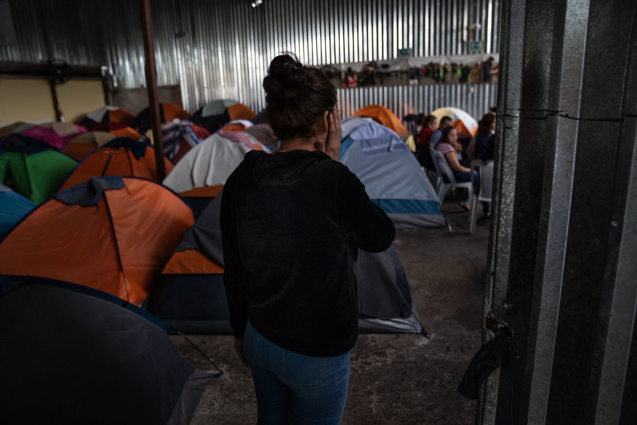 """A migrant who was returned to Mexico under the """"Remain in Mexico"""" policy walks at a shelter in Tijuana in May, 2019."""