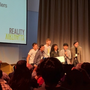 Adrian Babilinski accepting an award at the Reality Virtually Hackathon.