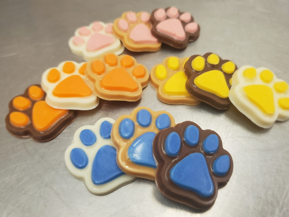 Confection Treats - Confection treats are molded from yogurt, peanut butter, or carob (again, sometimes all three) into a biscuit free treat. These are prefect for the dog that may be sensitive to grains. They are also much softer, perfect for older dogs that might find a crunchy biscuit uncomfortable.