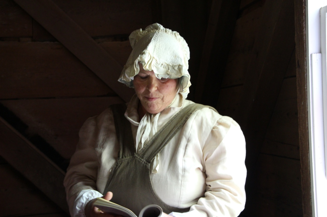 Linda Little, in character, reading from her novel Grist at Balmoral Grist Mill.