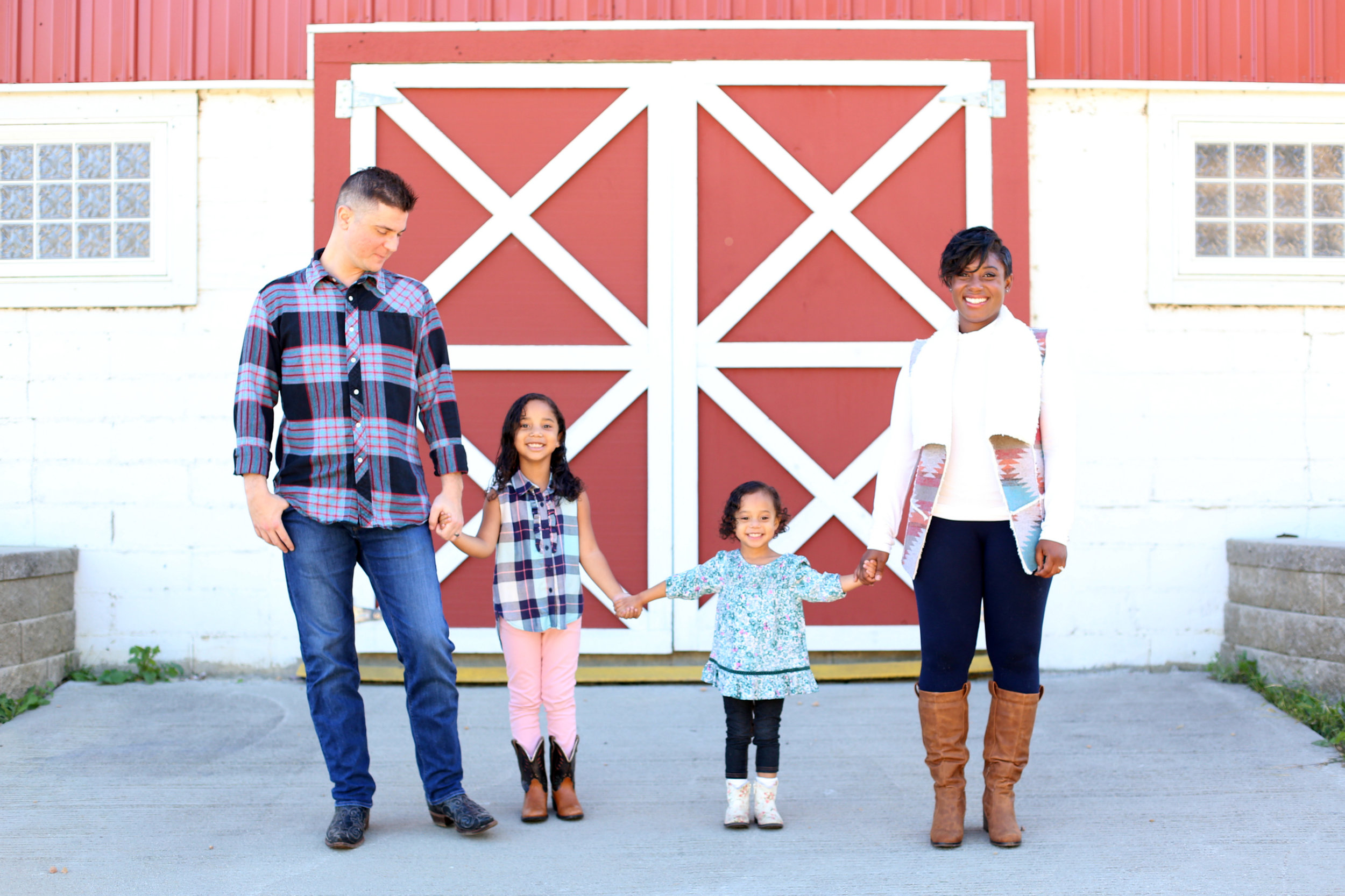 Brandie, her husband Brian, and two daughters Bella & Nava.