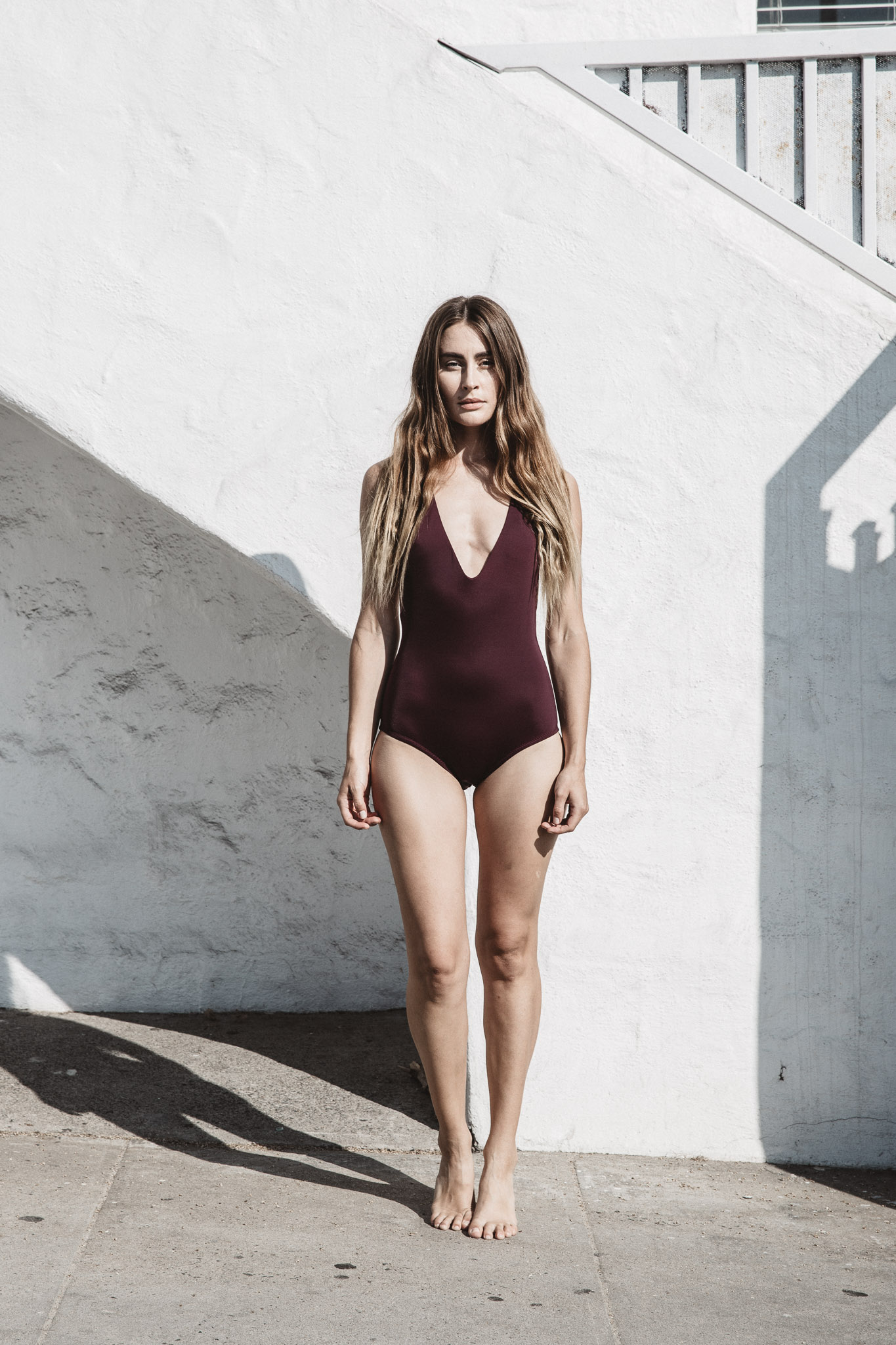 The Mallory Maillot in Hibiscus made from fabric using ECONYL fibers. Beauty, brains, and intention.