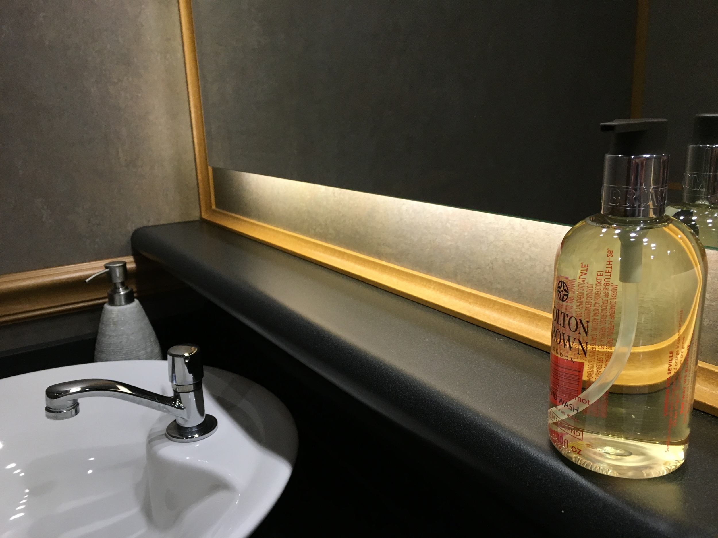 Every restroom is stationed with Molton Brown hand wash, the quintessential British luxury skincare brand.