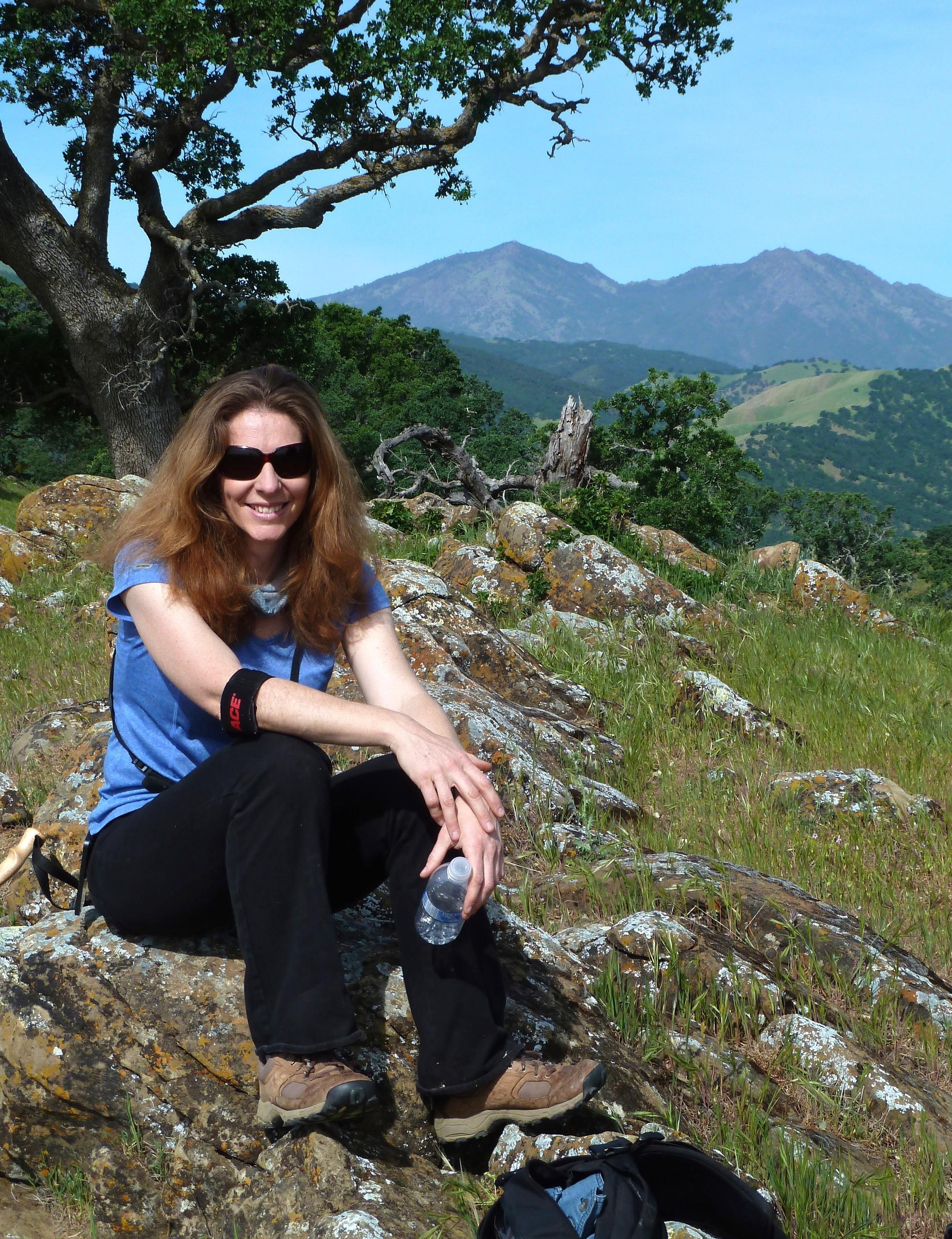 Eloine Chapman finds an ergonomically satisfying rock atop Round Valley.
