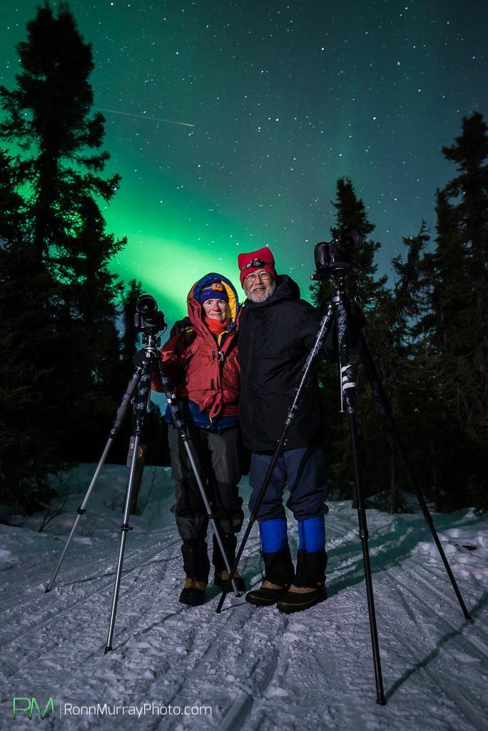 Margaret and Paul Hara stalk the auroras near Fairbanks, Alaska. Photo by Ronn Murray.