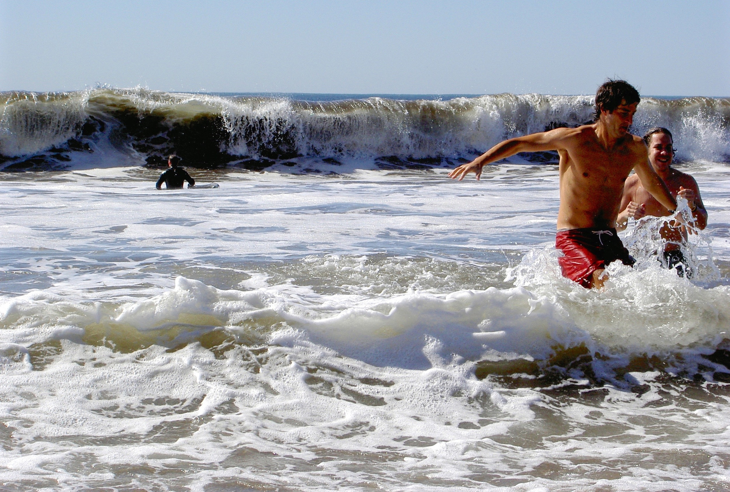 Boogie boarders ride the foam onto the Stinson beach shoreline.