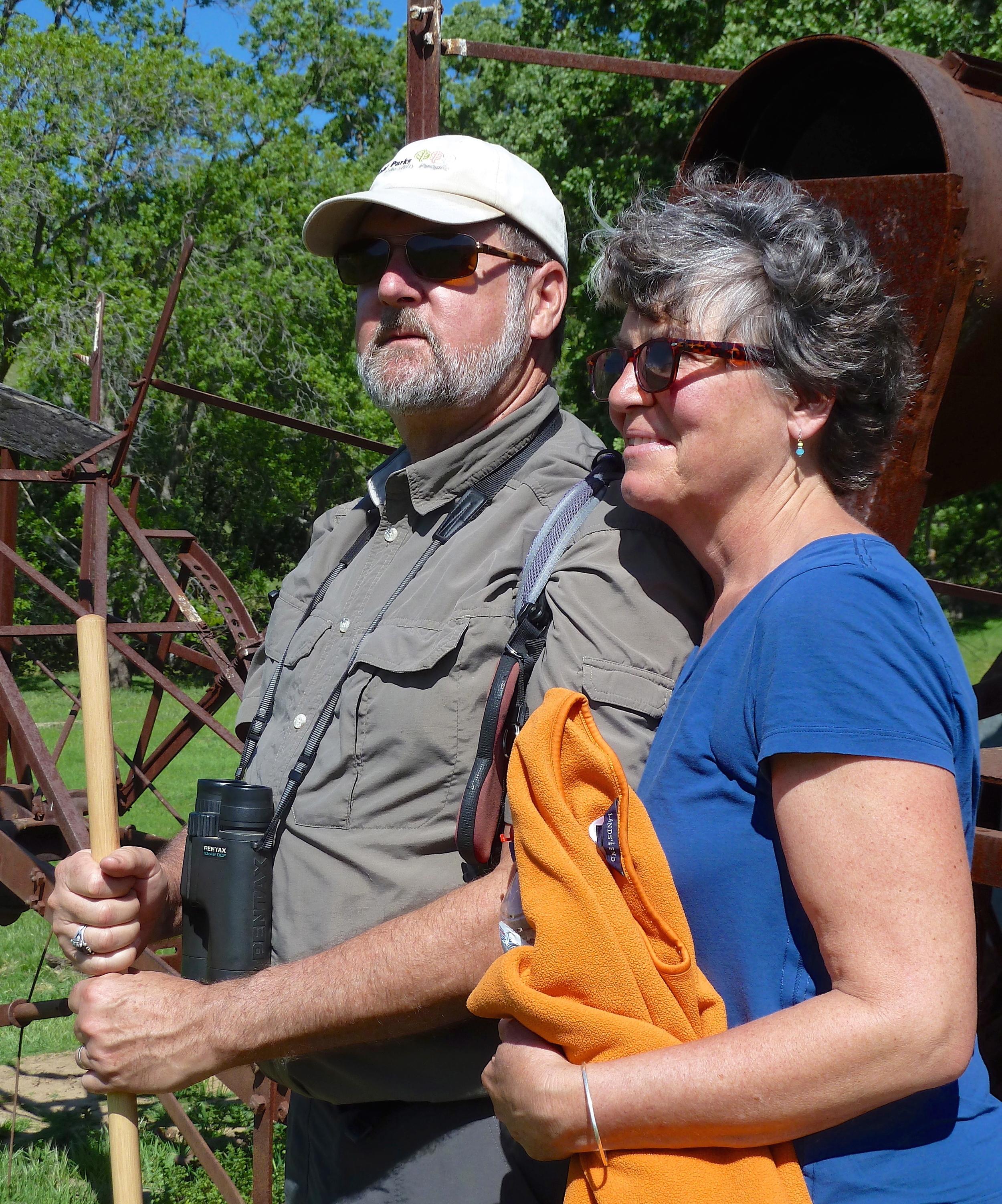 Bob Doyle and Tina Batt soak in the spring sunlight in Murphy Meadow, Round Valley Regional Preserve.