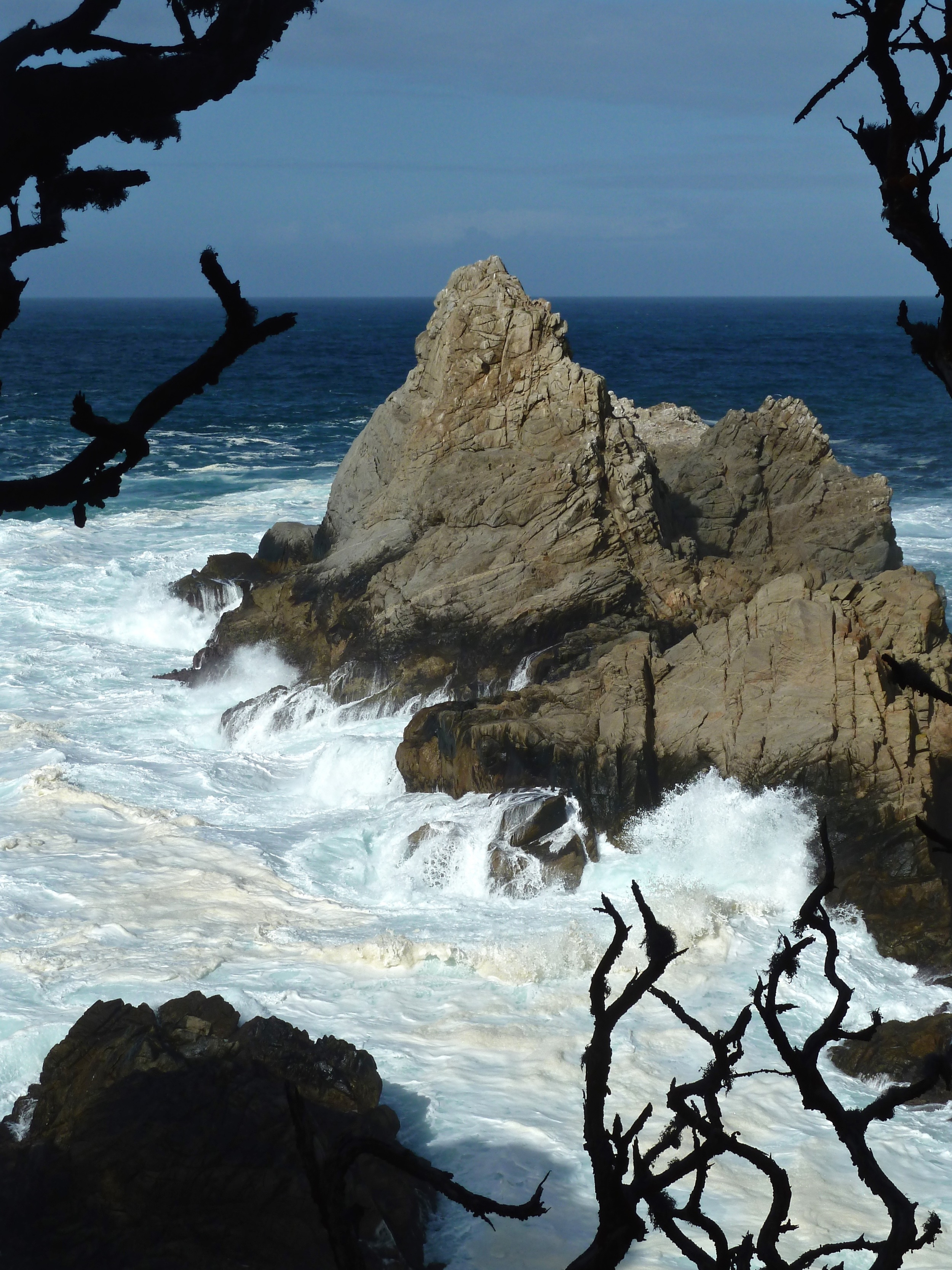 High tide and high winds churn the sea floor beneath the Pinnacle,  viewed from Cypress Grove Trail.