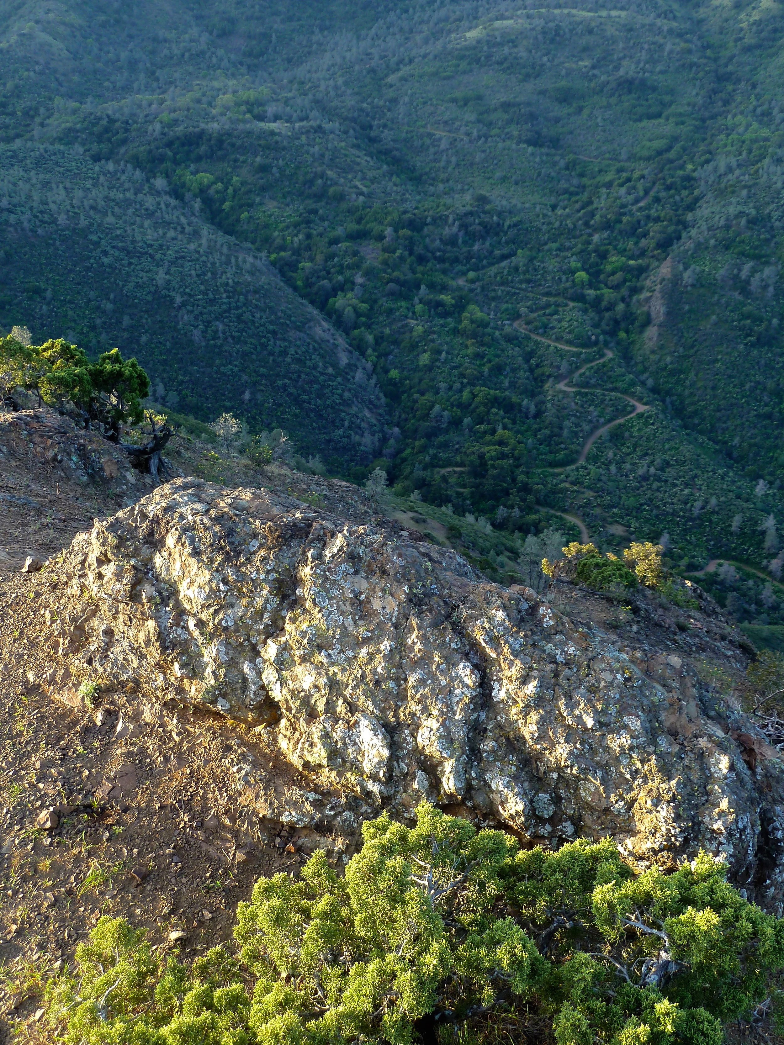 A rocky outcrop atop Mt. Diablo's Eagle Peak. Beyond, Mitchell Canyon Road snakes southward to Deer Flat.