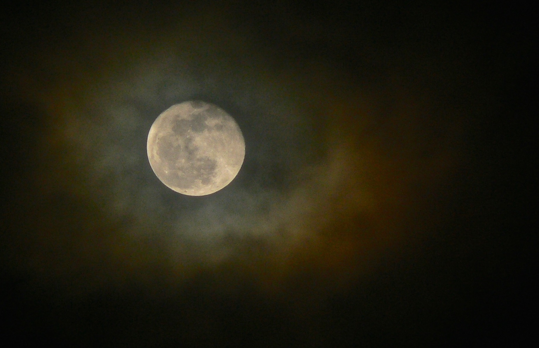 New Year's Moon 2010, when reflected sunlight made the quarter-million-mile journey to Earth and was refracted through a thin layer of cloud above Brentwood, California.