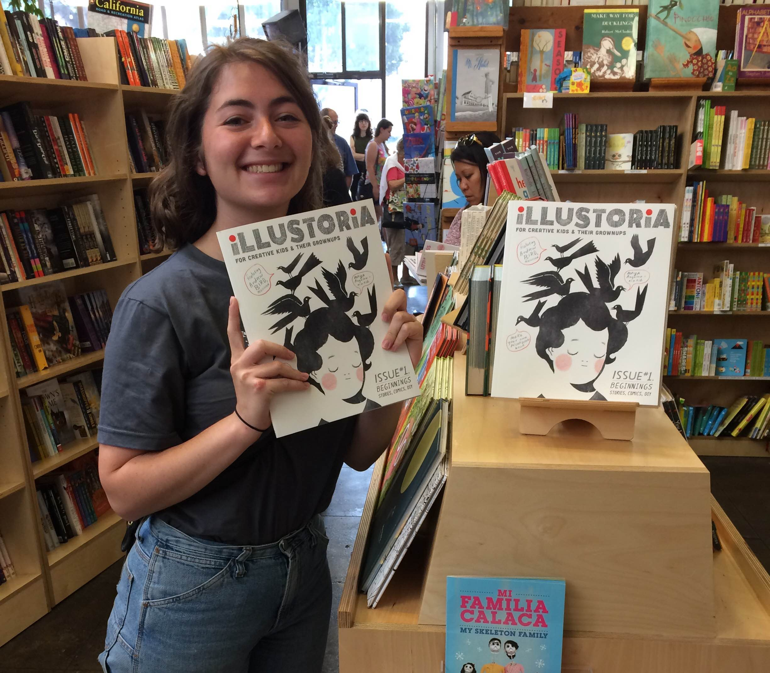 Claire holding the first issue of Illustoria at Skylight Books in Los Angeles.