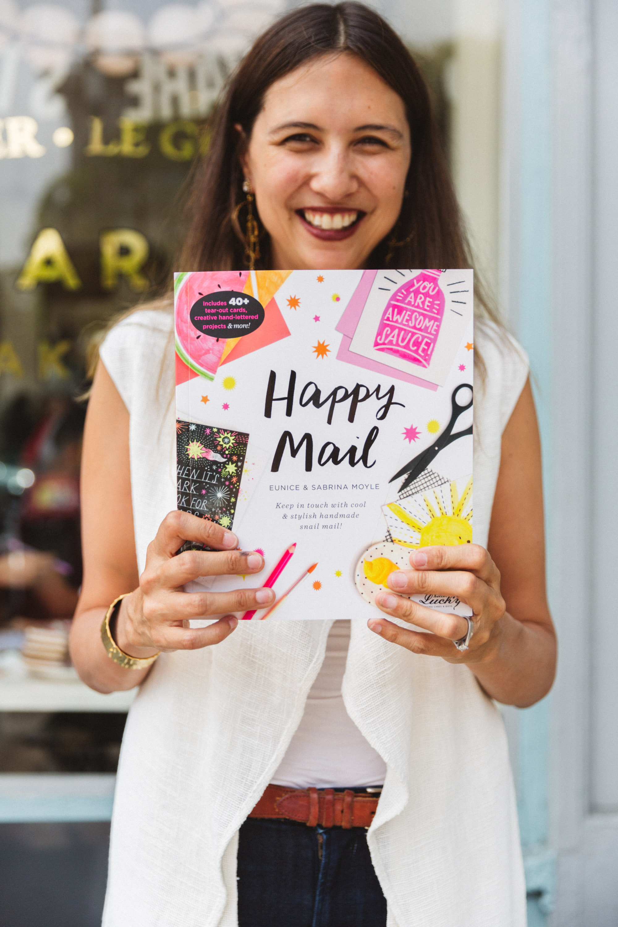 Sabrina holding a copy of  Happy Mail ! Photo © Zoe Larkin