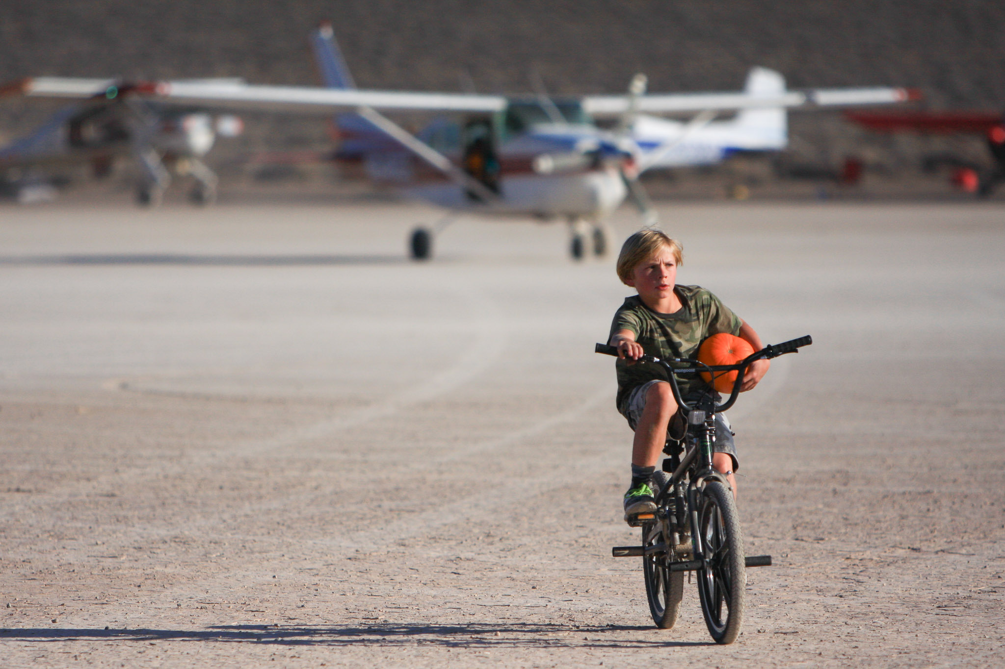 Everyone knows what it's like to be the kid on a bike at a desert fly-in, hauling ammo for the pumpkin drop.