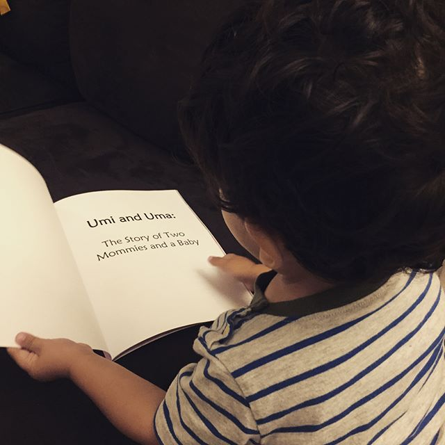 """Little man is busy reading his new book by @twomommiesandababy  Available on Amazon. """"Umi & Uma The Story of Two Mommies and a Baby"""""""
