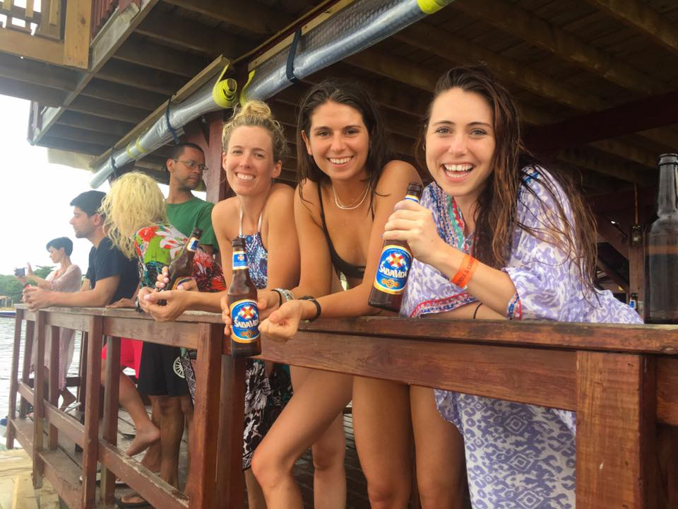 Callie, Atwood and Ally enjoying a beer while watching people get 'blobbed' into the water...