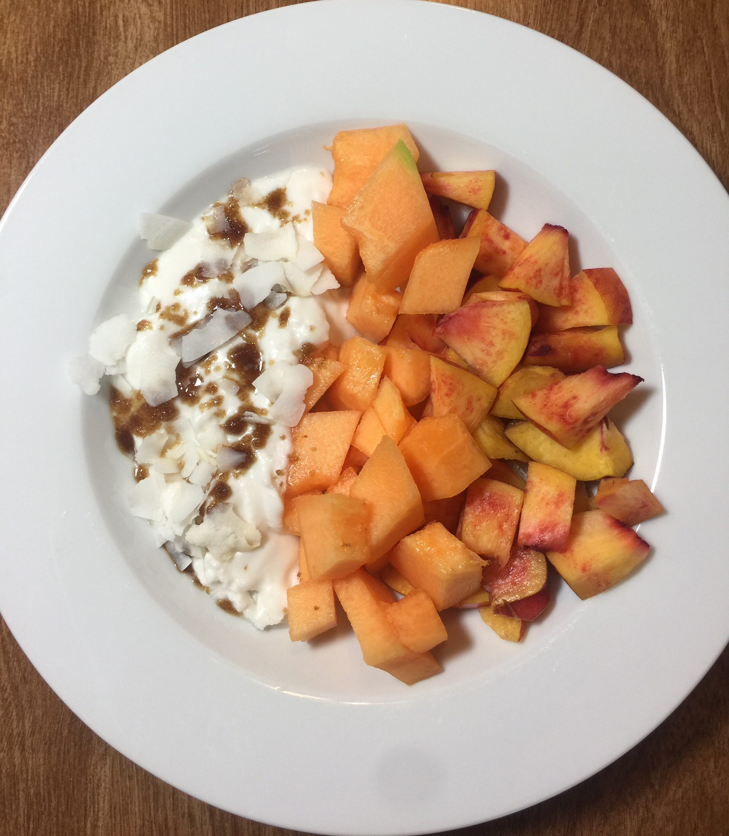 Cultured Coconut Yogurt with fruit, brown sugar and coconut flakes.