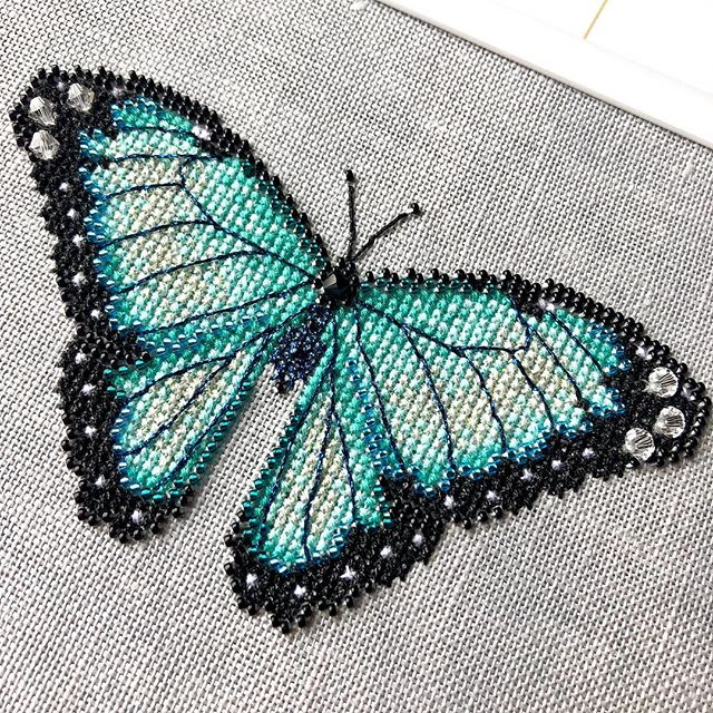 Lori's Butterflies 🦋 is a new collection I've been working on. There is a total of 5 patterns in the series and each one uses #kreinik #dmc Swarovski crystal beads and seed beads. They would look stunning stitched as a bell pull or as a long skinny framed piece. Link in bio to my website . . . #crossstitch #crossstitching #crossstitchpattern #butterfly #craftpattern #pdfpattern #shannonchristinedesigns #shannonwasilieff #pointdecroix #needlework #crossstitchdesigner #xstitch #stitchersofinstagram #xstitching #crossstitchersofinstagram #finishedstitching #finishedcrossstitch #commonbluemorpho #needleart #beadedcrossstitch