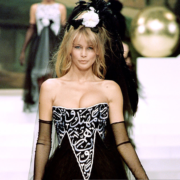"""The infamous 1994 Chanel """"Satanic Breasts"""" dress, which caused commotion for having a verse of the Koran across Claudia Schiffer chest."""