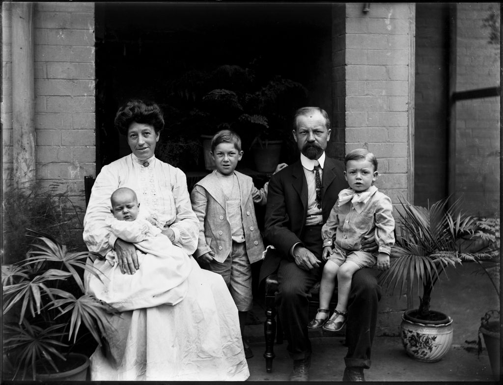 Family_portrait_with_mother,_father,_two_small_boys_and_baby_(3251833363).jpg