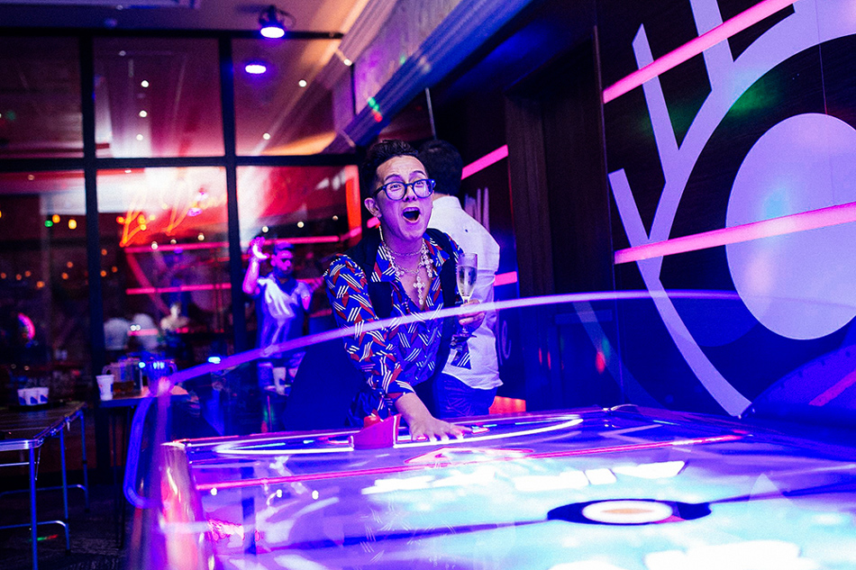 I was totally failing at air hockey... after just three glasses of champagne.