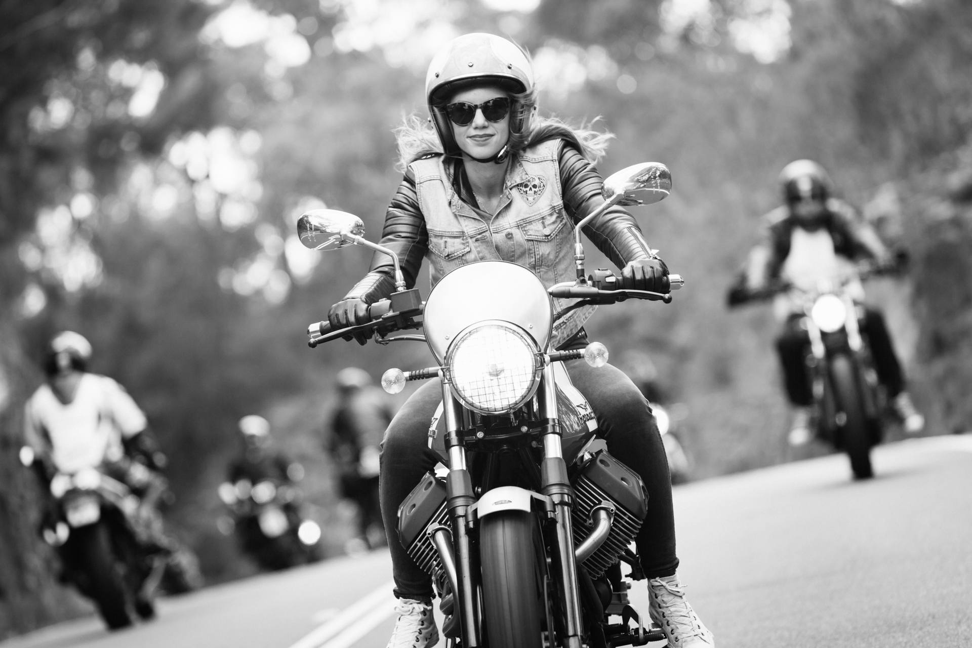 Nina from the Throttle Dolls on a Moto Guzzi V7 Scrambler