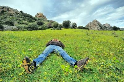 Man-dreaming-in-field