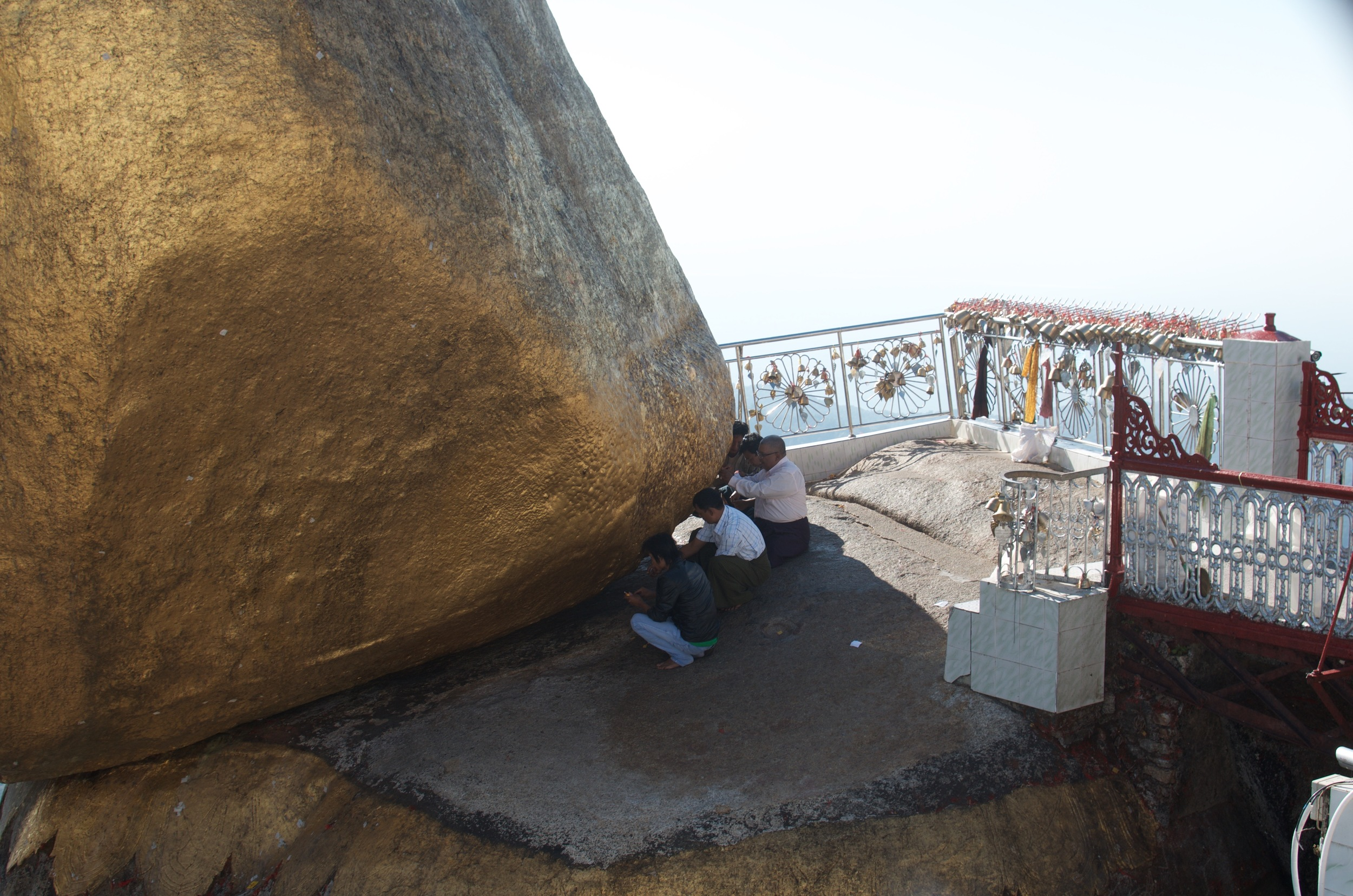 Men are allowed to cross the footbridge to the Rock to touch it and add gold leaves to preserve its sheen, but women are forbidden.
