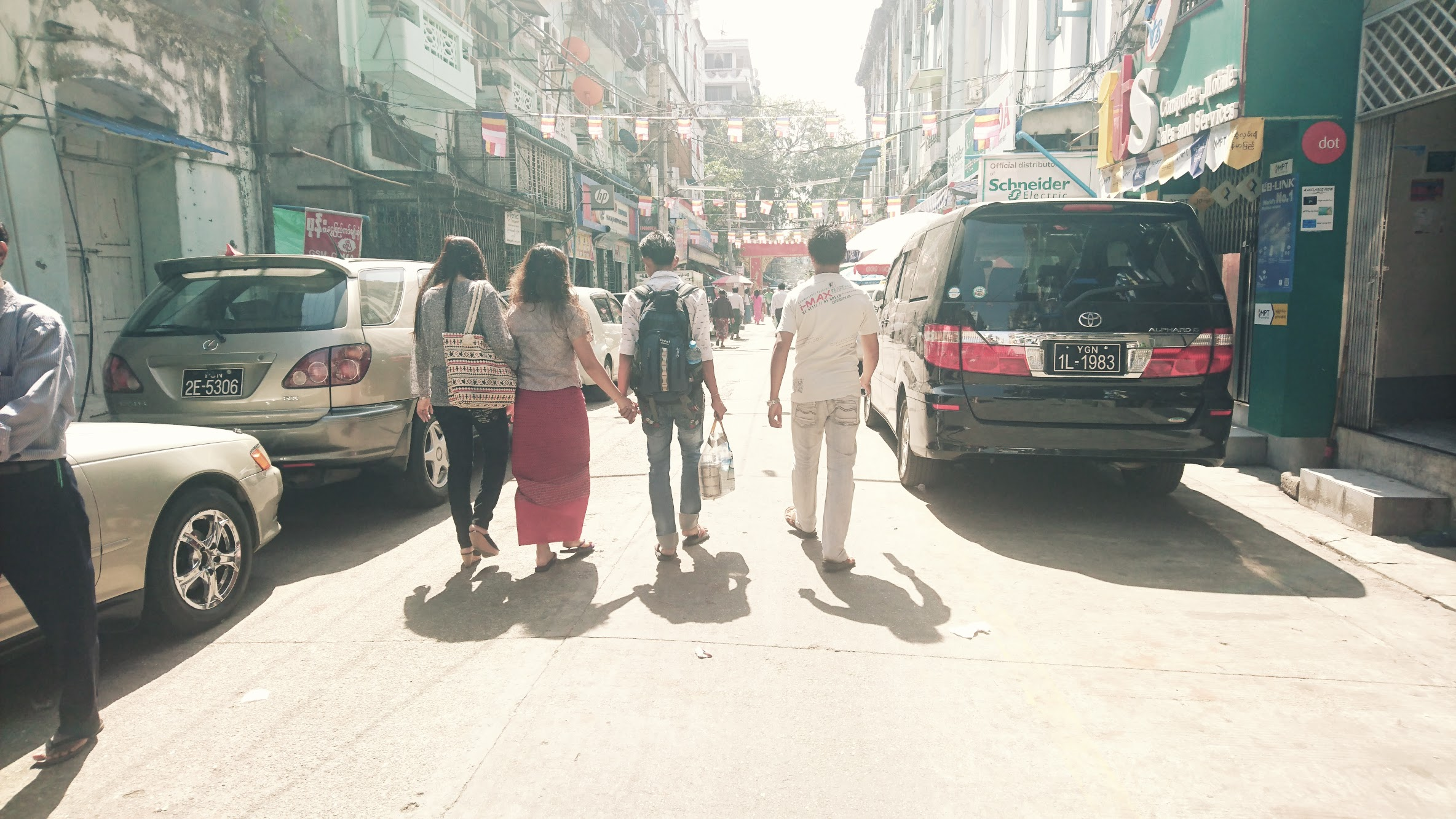 A photo that we feel captures the yin and yang of young Burmese culture today. In the past, everyone big and small wore the longyi and handholding was only permissible between people of the same gender (as a sign of close friendship). Now, teenagers are donning western garb more and more, and you see an increase in public displays of affection between couples.