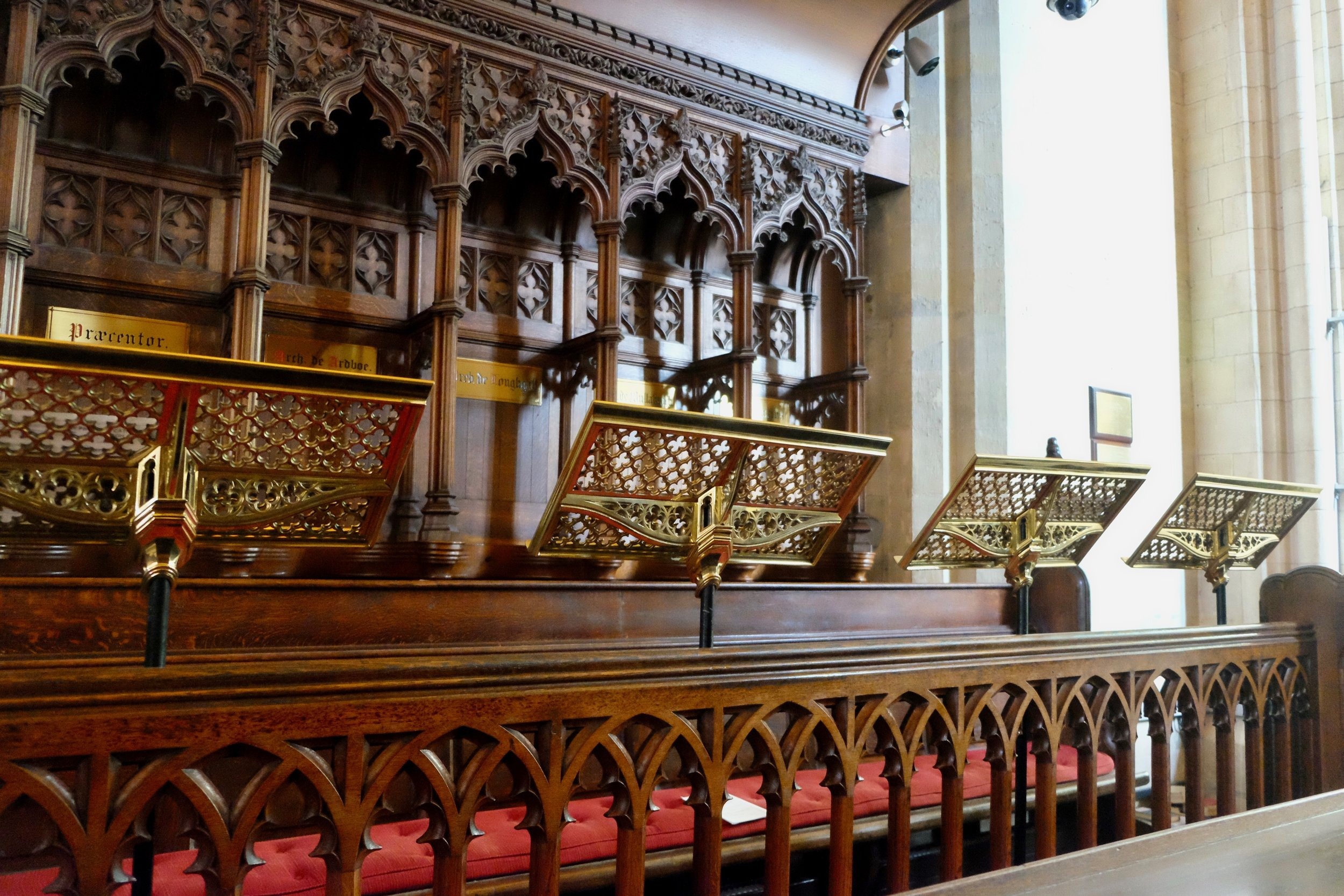 But still equally as beautiful in its own way, like the choir section with its luminous music stands and intricately carved pews.