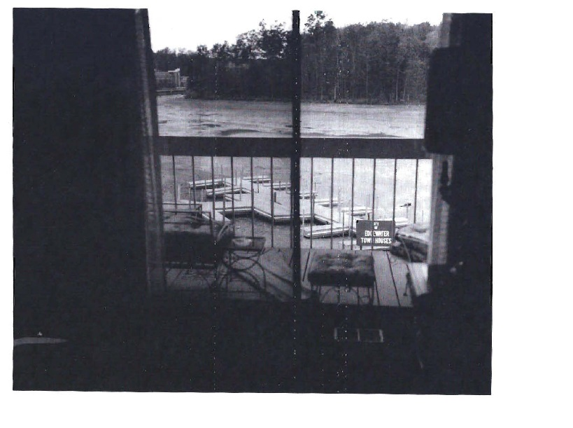 """A view of the first dock. Note the Cluster name on the sign """"Edgewater Townhomes"""""""