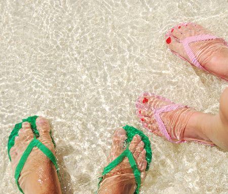 5480421_S_Flip_flops_two_pair_water_sun_women_feet_toes_nails.jpg