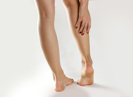 88767426_S_woman_leg_cramp_heel_pain_Achilles_tendonitis_injury.jpg