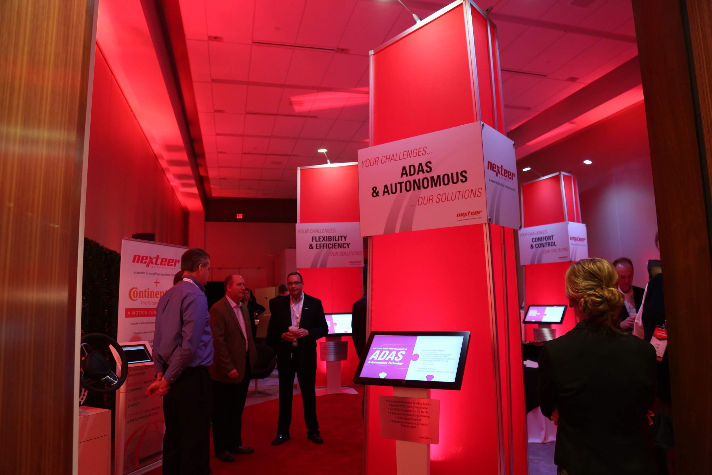 """Nexteer's 2017 North American International Auto Show Hospitality Suite:  Our sales team reported that customers were not aware of several solutions we offer for their biggest challenges. With that in mind, I developed the """"Solution Station"""" theme for our hospitality suite. Each touchscreen display offered a separate solution to our customer's greatest challenges in ADAS & Autonomous Driving, Safety & Security, Efficiency & Flexibility, and Control & Comfort. I developed the template for the solution stations and customized them with graphics,imagery, & videos tailored to each challenge +solution. We have now implemented the same """"solution station"""" approach at our global trade shows."""