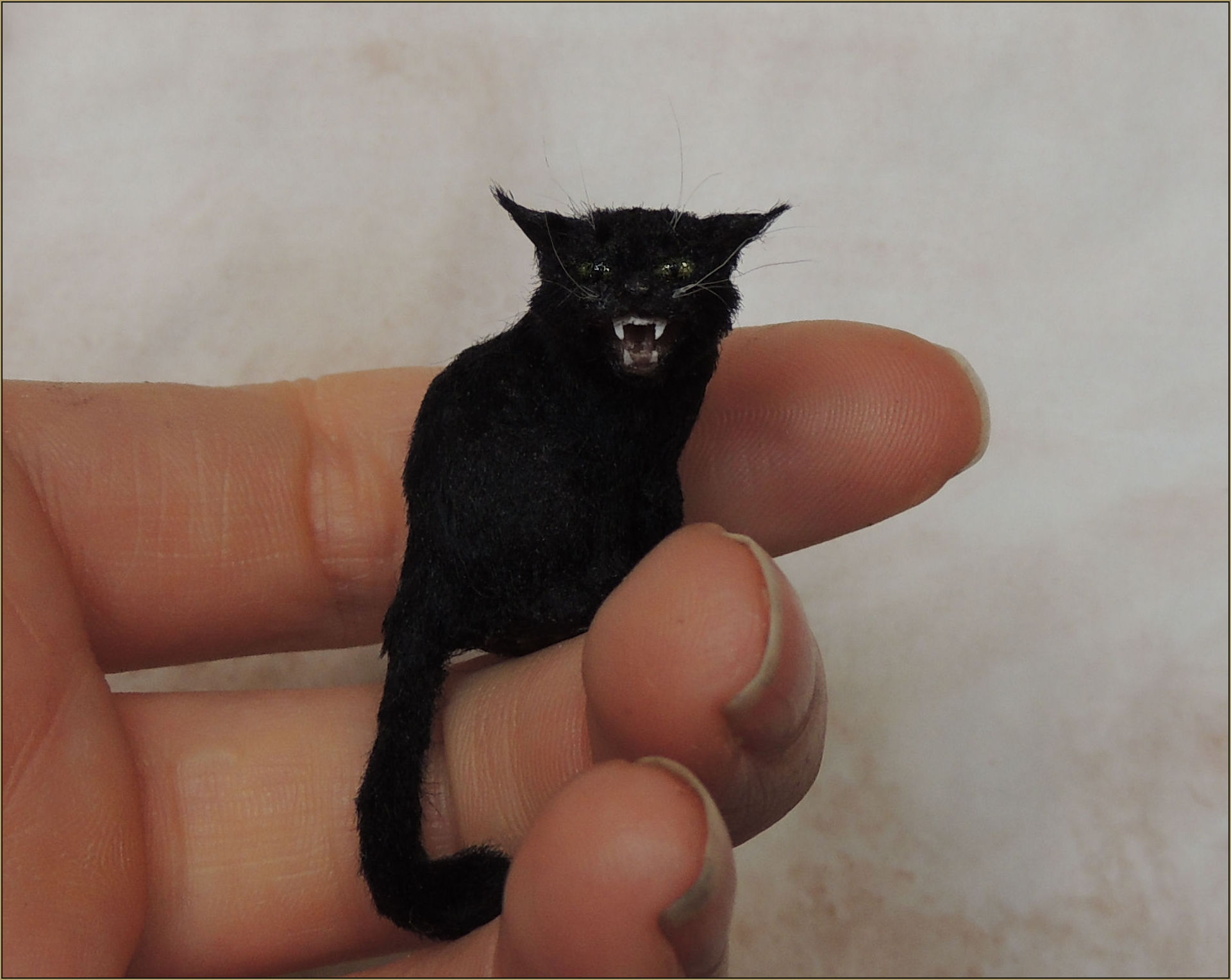 Scale: 1:12th    Medium: Polymer clay mixed media with a coat made of black viscose yarn. The eyes are hand painted.    Dimensions: 2.8 cm from base to the top of the head. 4.8cm Including the length of the tail.    Year: 2015