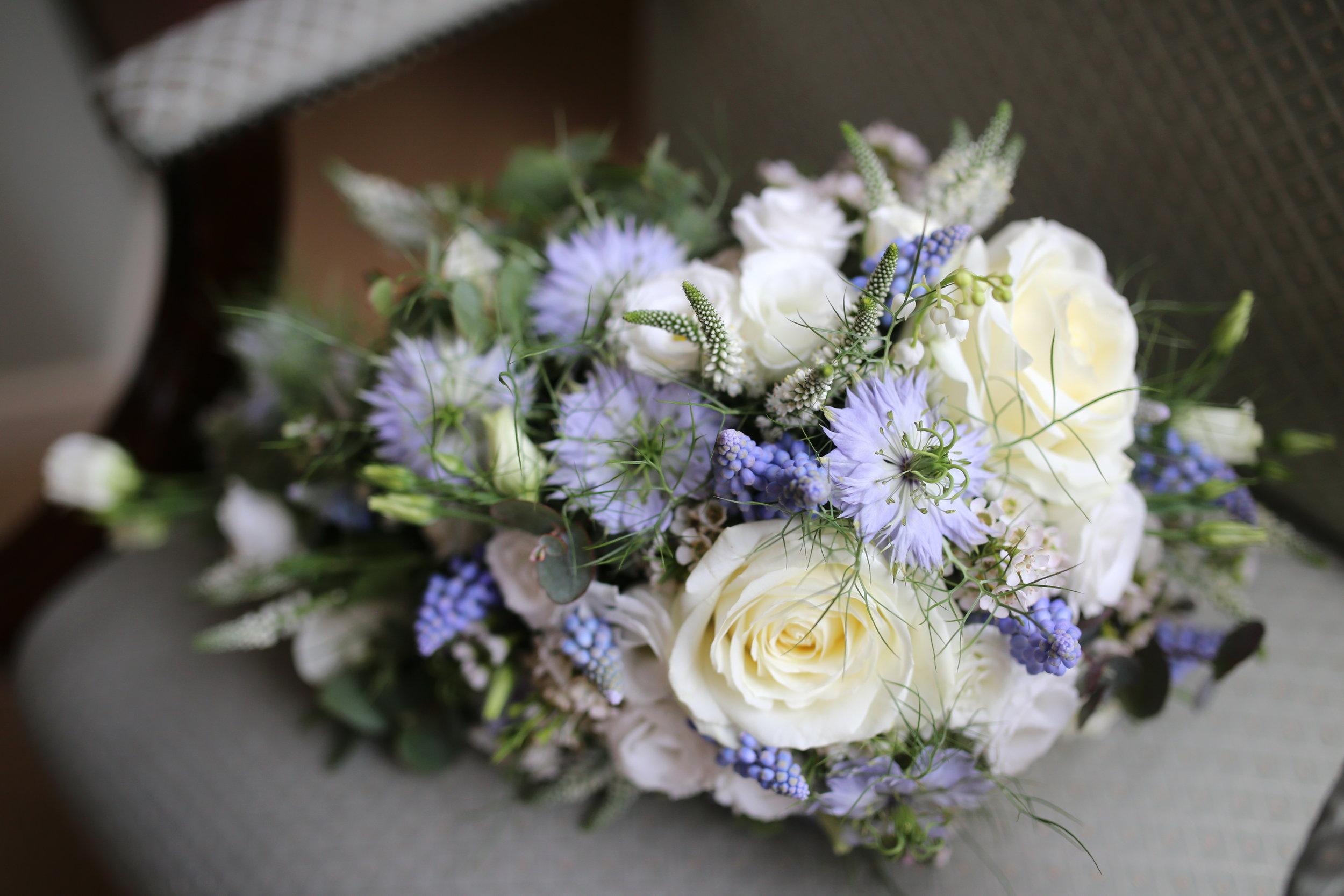 MIRIAM_FAITH_WEDDING_FLOWERS_BRIDE_BOUQUET_BLUE_WHITE_NIGELLA_ROSES_CASCADE.JPG