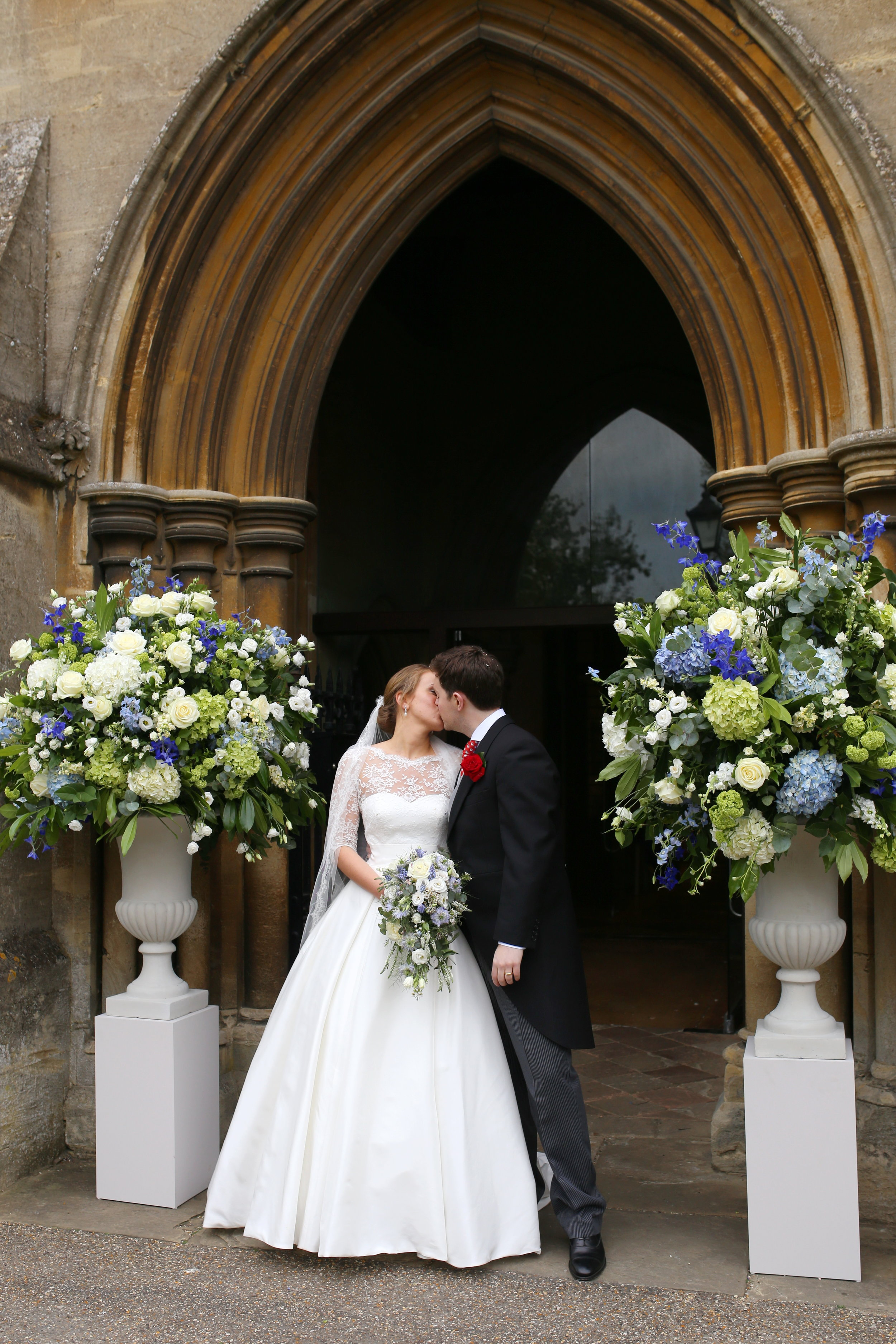 MIRIAM_FAITH_WEDDING_FLOWERS_CEREMONY_URN_CHURCH_PEDESTAL_BLUE_WHITE_GREEN_CASCADE.JPG