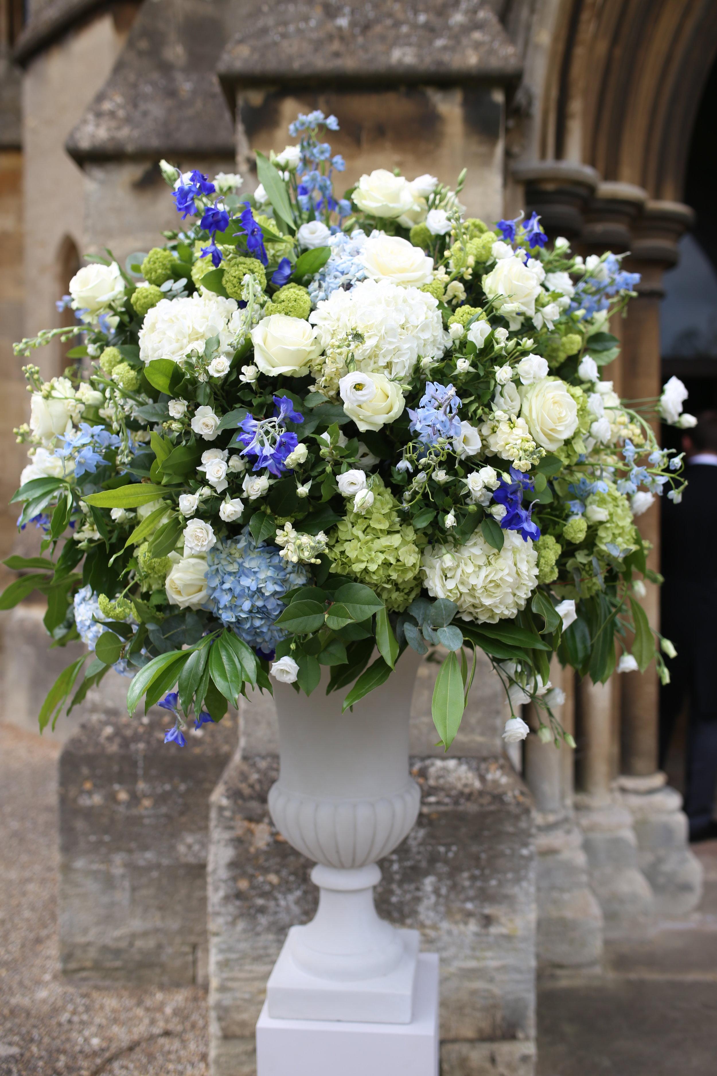 MIRIAM_FAITH_WEDDING_FLOWERS_CEREMONY_URN_CHURCH_PEDESTAL_BLUE_WHITE_GREEN_.JPG