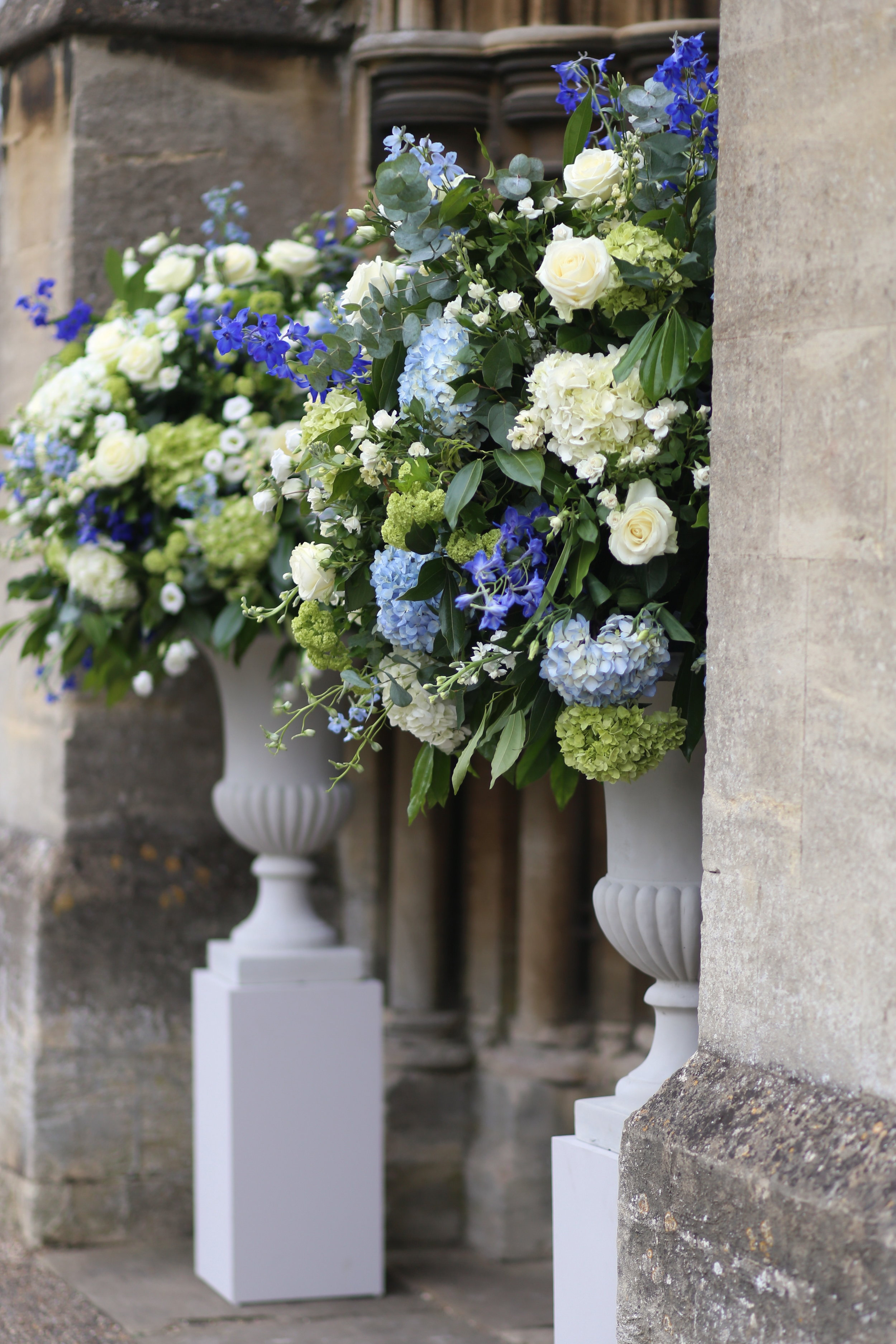 MIRIAM_FAITH_WEDDING_FLOWERS_CEREMONY_URN_CHURCH_PEDESTAL_BLUE_WHITE_GREEN_GREY.JPG