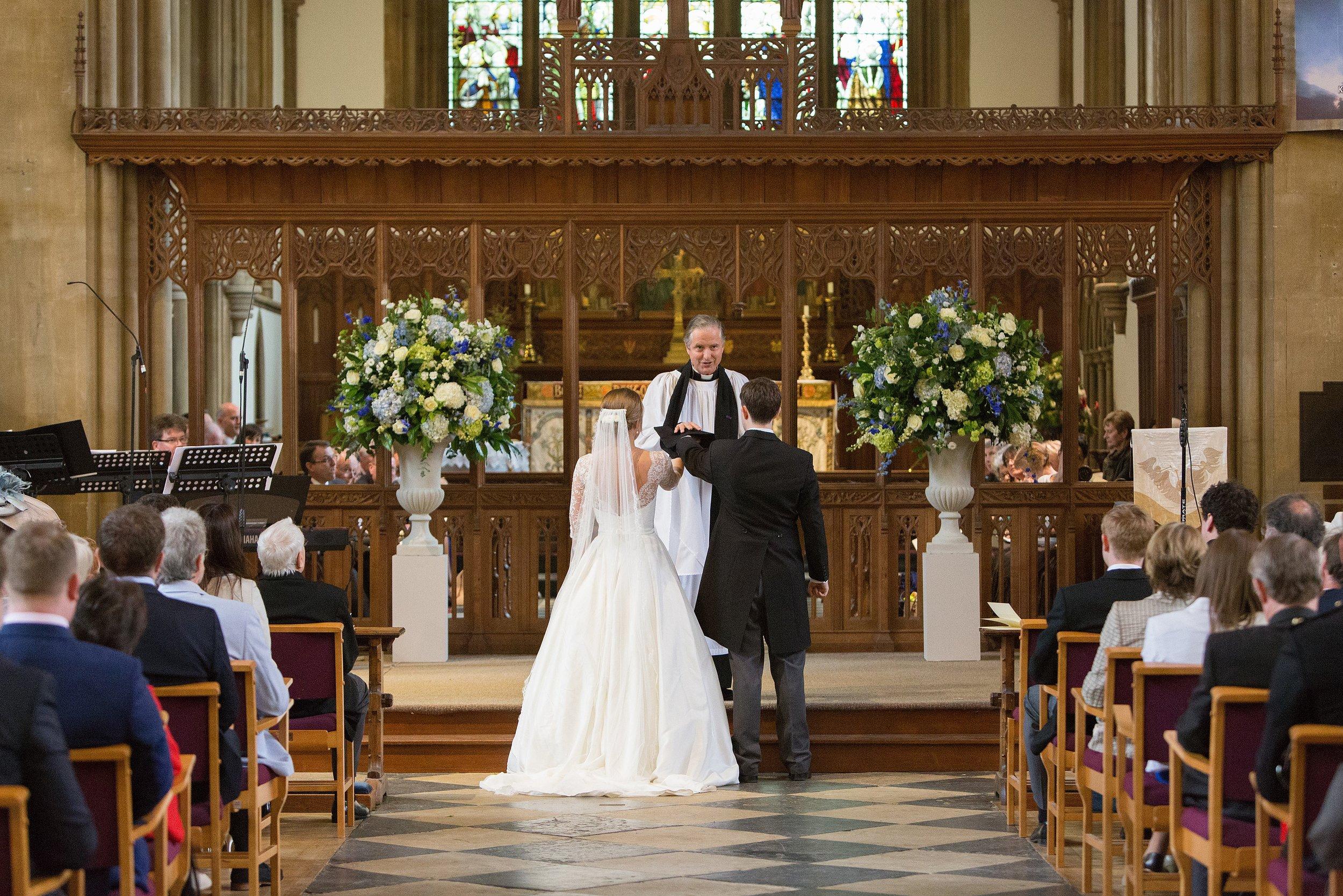 MIRIAM_FAITH_WEDDING_FLOWERS_CEREMONY_URN_CHURCH_PEDESTAL_BLUE_WHITE_GREEN_VOW.JPG