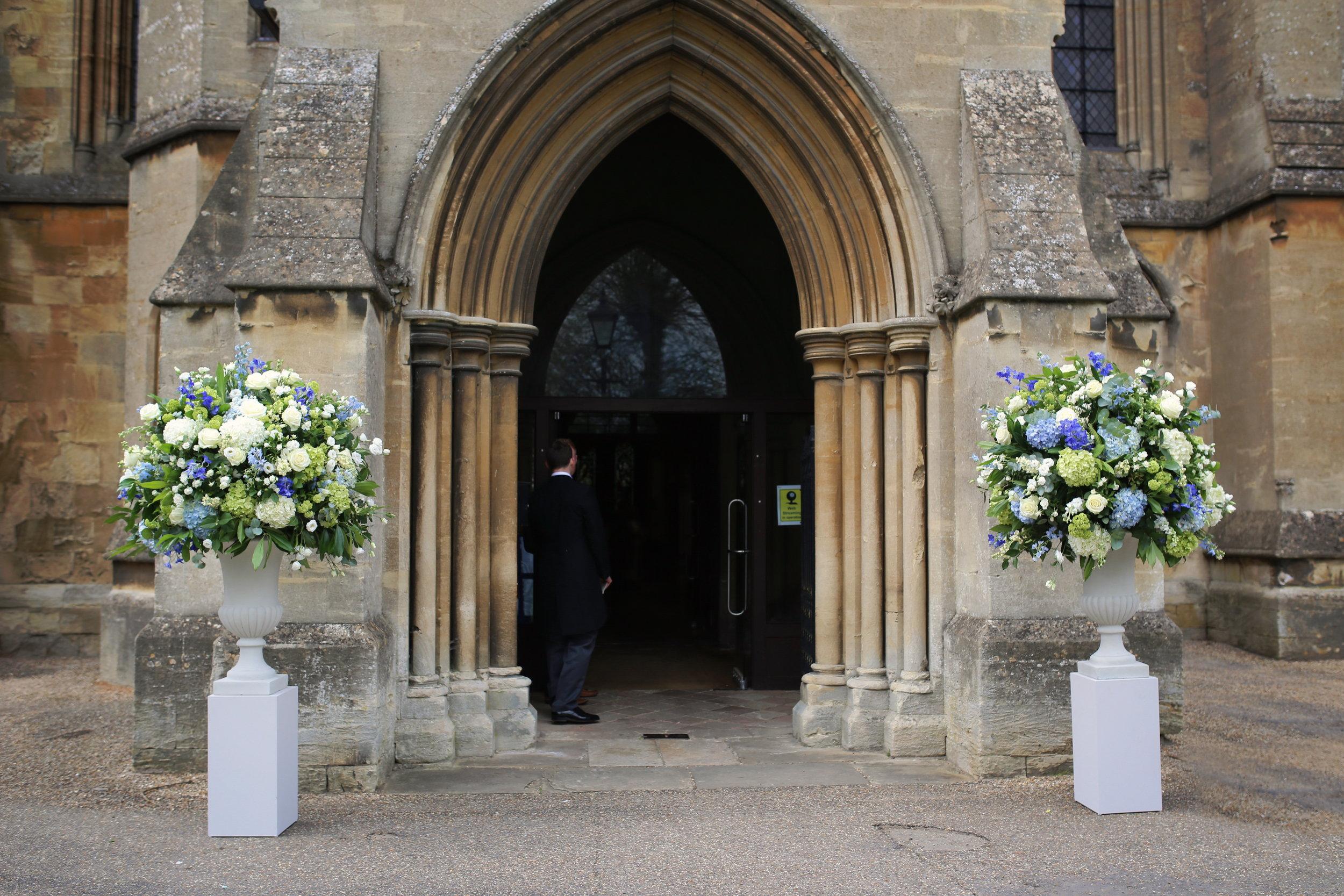 MIRIAM_FAITH_WEDDING_FLOWERS_CEREMONY_URN_CHURCH_PEDESTAL_BLUE_WHITE_GREEN.JPG