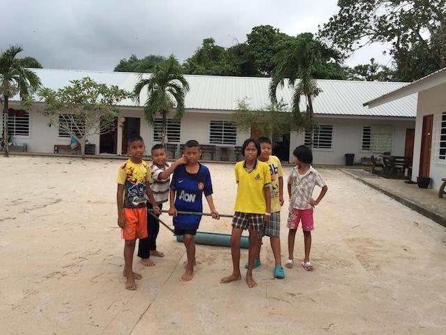 Children flattening sand.JPG