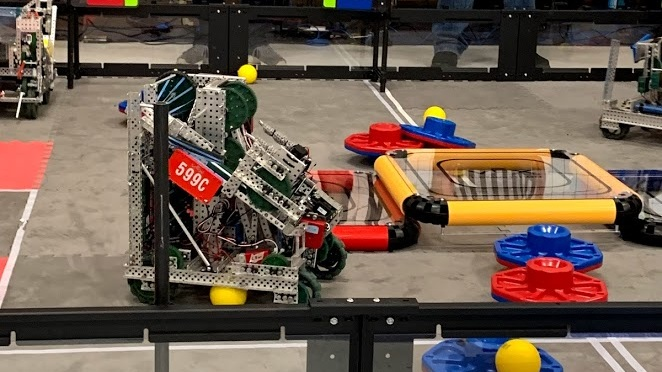 2018-2019 VRC - 599A, B, C   The VEX teams participated in TURNING POINT, where robots fitting in an 18x18x18 cube had to flip and score caps to their alliance color, as well as shoot balls to reorient flags at multiple high levels.   AWARDS    599A:  Excellence (Reseda)   599B : 2x Design (Reseda, Compton), Sportsmanship (Reseda)   599C:  Tournament Champion (Magnolia), Excellence (Magnolia), 2x Robot Skills (Holmes, Magnolia),  Design  (California State),   Think Award   (VEX Worlds - Math Division)