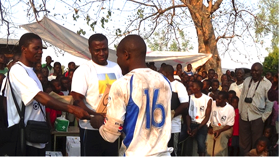 Photo: Orlando team  receiving first prize from  Bornwell Yona  (Children's Club Coordinator)   as  Emmanuel Uaewzuoke  (Country Director) looks on.