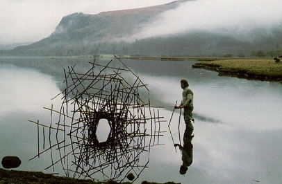 Andy Goldsworthy installing an in-site art piece.
