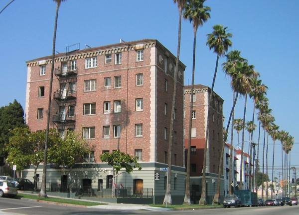 This Koreatown apartment building was purchased for $7 million—$127,000 per unit—in 2015. It and thousands of other units could be acquired with public funds and used to house those displaced by new development. Source:  MultifamilyBiz .